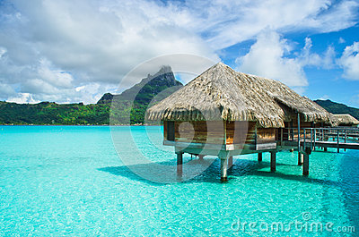 thatched-roof-honeymoon-bungalow-bora-bora-luxury-overwater-vacation-resort-clear-blue-lagoon-view-64403992